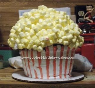 Homemade Popcorn Cake: I made this popcorn cake using the Giant Cupcake Pan. Stripped the bottom Red and White.   I mixed mini marshmallows with yellow sparkle writing gel, frosted