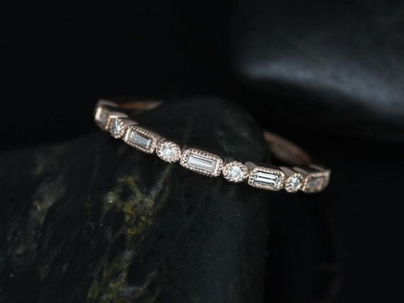 Tired of seeing the same styles of vintage bands?! This design is an edgy version of the classic baguette or round cut eternity band. Not only does is