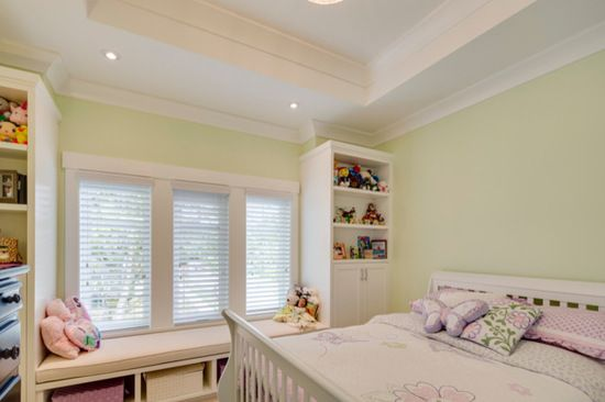 A soft, inviting pastel green covers the walls of this adorable girls room-it's sweet, functional, and stylish all rolled into one!