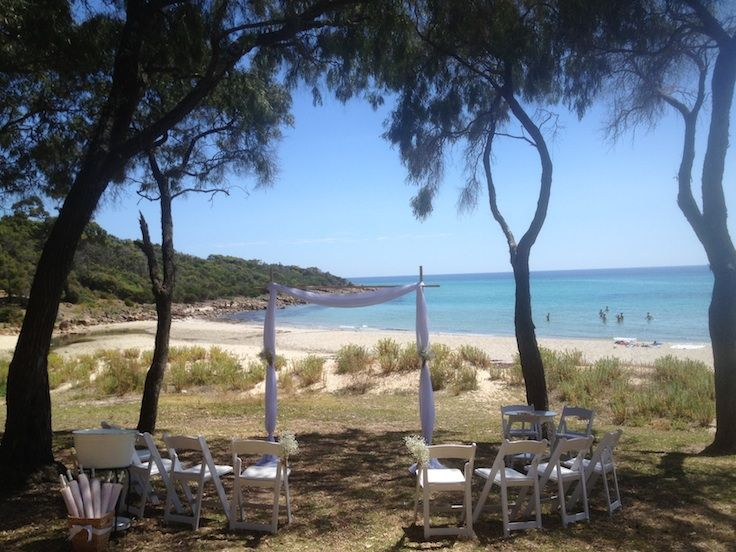 intimate beach ceremony at Meelup, Western Australia. styling and set-up by Ferguson Valley Events. gladiator chairs, arch, beach, baby's breath.
