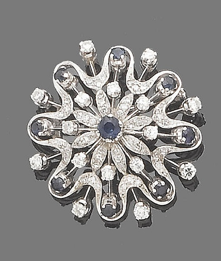 A sapphire and diamond starburst brooch  Of openwork design, set throughout with brilliant and single-cut diamonds and circular-cut sapphires, diamonds approx. 1.40ct. total, fitted case by Collingwood of Conduit St. Ltd., 46 Conduit St., W1