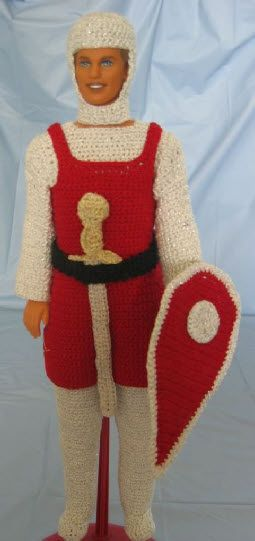Turn a Ken doll into a dashing Knight. This free pattern comes with instructions to make an all in one garment which includes his boots, tunic, head covering, belt, shield and sword.
