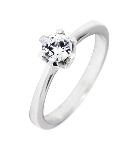 El anillo Modelo SARA NAVARRO 4 es un bello diseño que recuerda a la alta joyería tradicional, con el toque creativo de la diseñadora Sara Navarro, lo que actualiza la joya. De este modo, obtenemos un anillo de diamantes de oro de 18 quilates, perfecto como solitario de pedida, o como un regalo especial para las mujeres amantes de las joyas vintage.