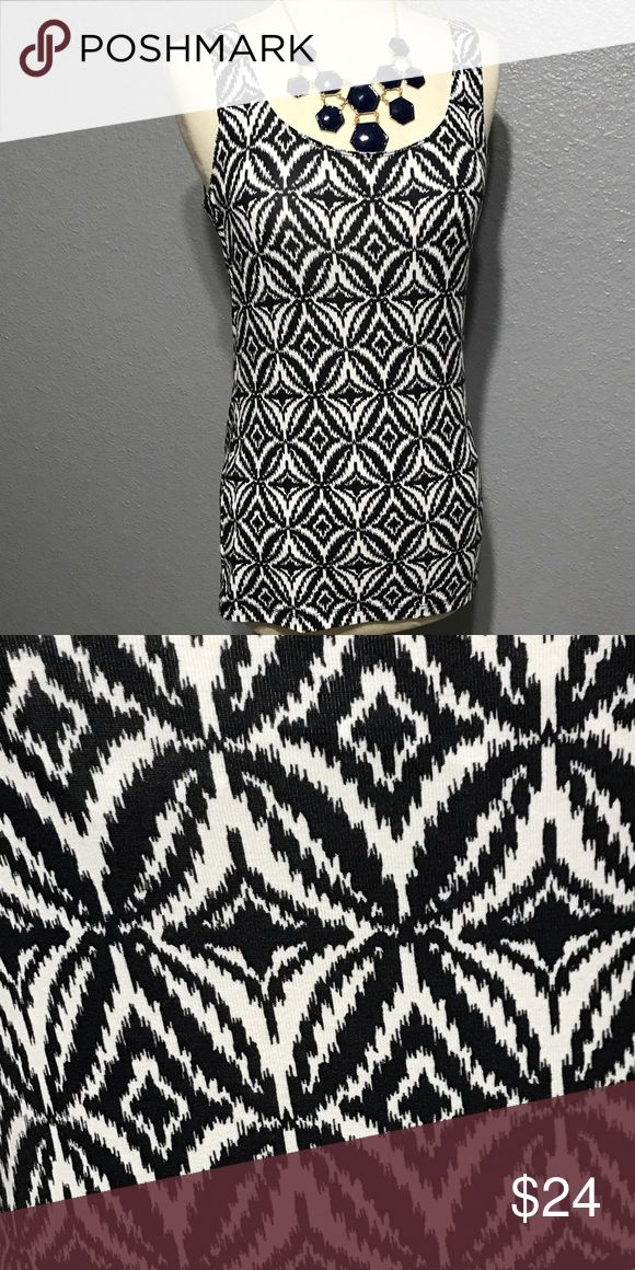 """🎁🌀NWT Banana Republic IKAT Top with Shelf Bra S Sleeveless top from Banana Republic has the popular Ikat print.  It soft and comfortable and has a built in shelf bra.  Cotton/spandex blend  🔘length 26"""" 🔘bust 16"""" across 🔘color: navy/white  🔘condition: NWT  ❌I do not trade  ✔️I accept reasonable offers  ✔️I ship fast - same day/next day  🚭All items come from a pet free/smoke free home. Banana Republic Tops Camisoles"""