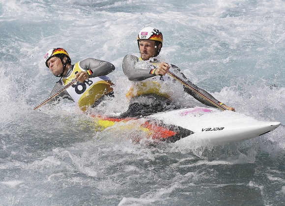 David Schroeder, front, and Frank Henze of Germany compete in the heats of the C-2 men's canoe double slalom at Lee Valley Whitewater Center, at the 2012 Summer Olympics, Monday, July 30, 2012, in London. (AP Photo/Kirsty Wigglesworth)