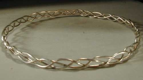Very pretty, if I can get silver 18 gauge wire I'm sure I can get my Dad to help me weld the ends together.