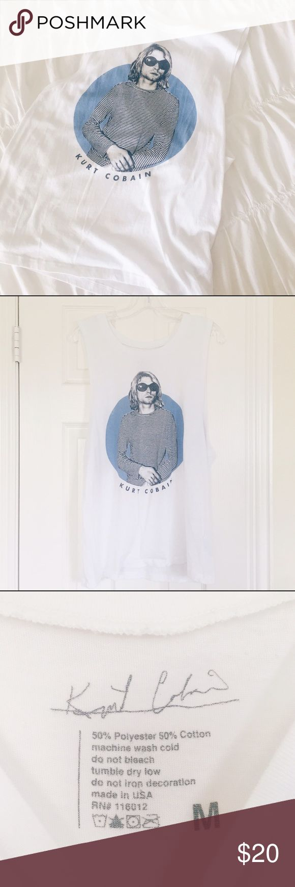 🎶 Kurt Cobain Muscle Tee Worn once. Size medium but can be worn by a smaller size as a long / oversized fit. Looks great with bralette and leggings for casual wear. Purchased at Urban Outfitters Urban Outfitters Tops Muscle Tees