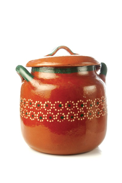 """The olla, a tall clay pot, is an essential tool in Mexican kitchens. Glazed on the outside only, these porous cooking vessels add an earthy flavor to long simmered dishes like soups and stews and frijoles de olla (literally, """"pot"""" beans)."""
