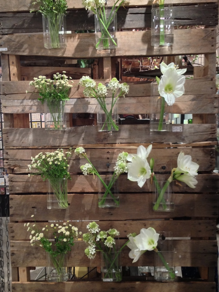 BOMISCH BLOG | Glass wall pockets as vases! Love this wall. $24