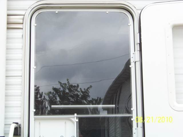 Step-by-step tutorial for adding Lexan/plexi-glass to RV's screen door.  Let in the light without losing heat or A/C!