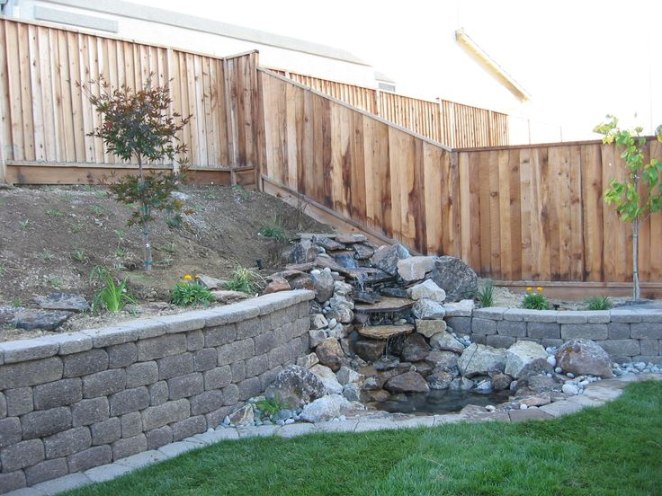 Water Feature Integrated Into Retaining Wall Though The Wall Should Be Made