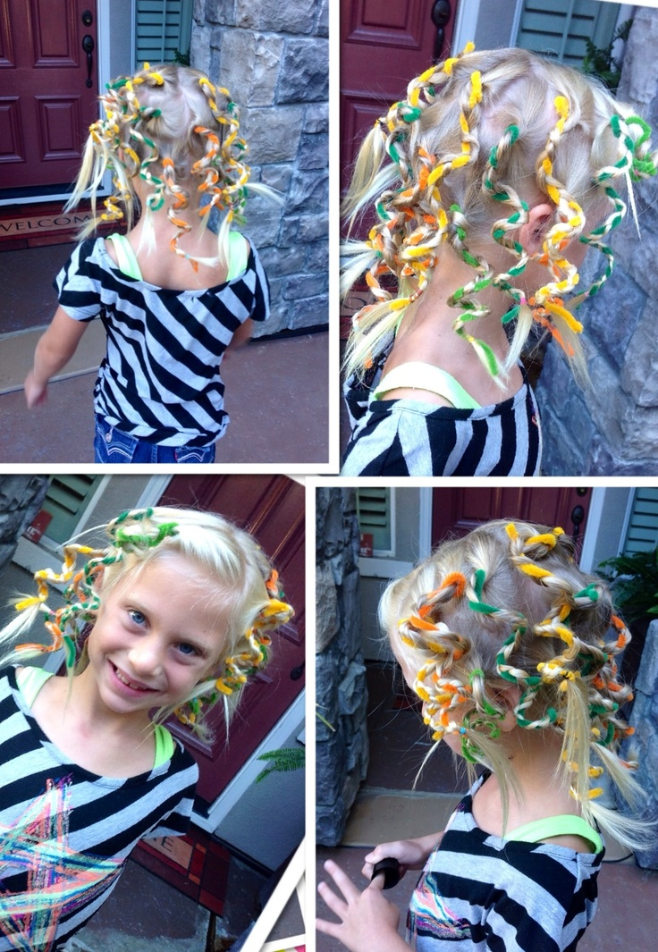 Crazy hair day. Pipe cleaners braided into sections of the hair.