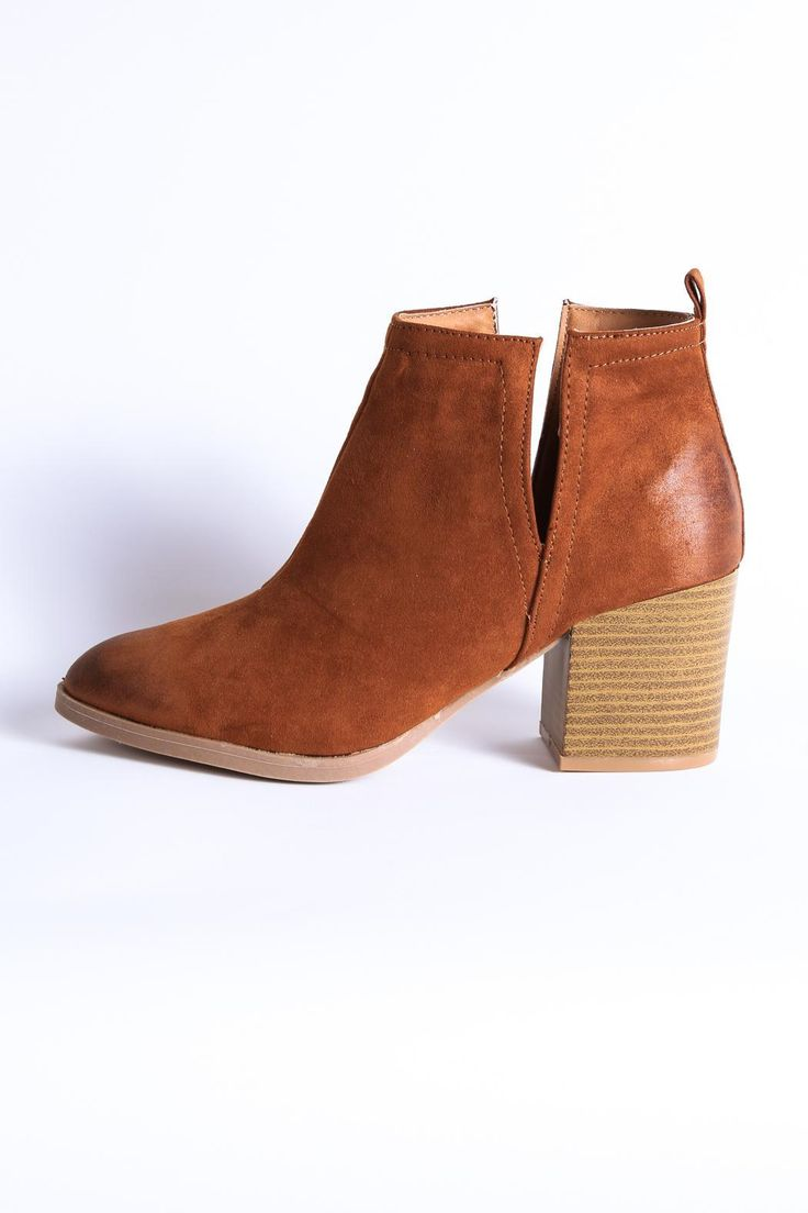 """Our Wilson Cutout Boot is so stylish yet incredibly simple. She will compliment your outfits all year long. Toe: Pointed. Style: Minimalist. Closure: Slip on. Deep V side cutouts. Faux-wood heel. Oil rubbed finish look. Padded footbed under toe. Wear with footie or no-show socks. Normal width. Fit is loose without socks; just right with socks.    Heel height:3"""" heel height. 5"""" shaftheight   Wilson Cutout Boot by Qupid. Shoes - Booties - Heeled Georgia"""