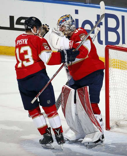 SUNRISE, FL - MARCH 23: Goaltender James Reimer #34 of the Florida Panthers and teammate Mark Pysyk #13 celebrate their win against the Arizona Coyotes at the BB&T Center on March 23, 2017 in Sunrise, Florida. (Photo by Eliot J. Schechter/NHLI via Getty Images)