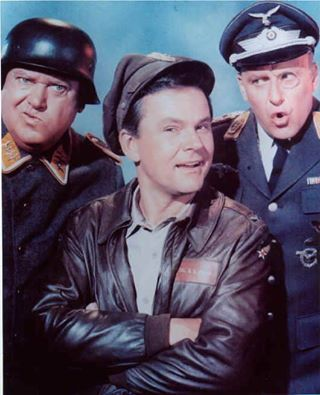 Hogans Heroes was an American TV sitcom set in a German POW camp during World War II. Bob Crane starred as Colonel Robert E. Hogan, coordinating an international crew of Allied prisoners running a Special Operations group from the camp. Werner Klemperer played Colonel Klink, the commandant of the camp, and John Banner was the inept sergeant-of-the-guard, Hans Schultz. Other characters included Newkirk (Richard Dawson), LeBeau (Robert Clary), Kinchloe (Ivan Dixon), and Carter (Larry Hovis).