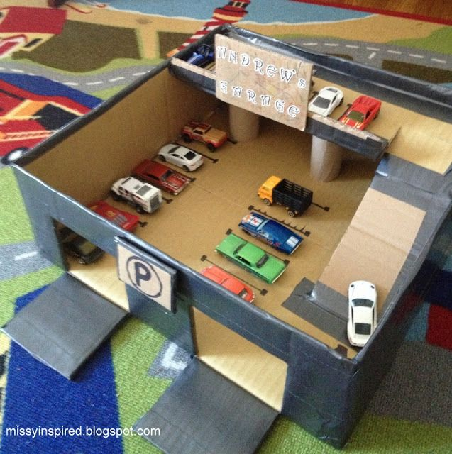 Fazer uma garagem em cartão para carrinhos pequenos. Tutorial em:  http://www.missyinspired.blogspot.pt/2013/01/matchbox-car-garage.html  Make a matchbox car garage from a cardboard box and duct tape