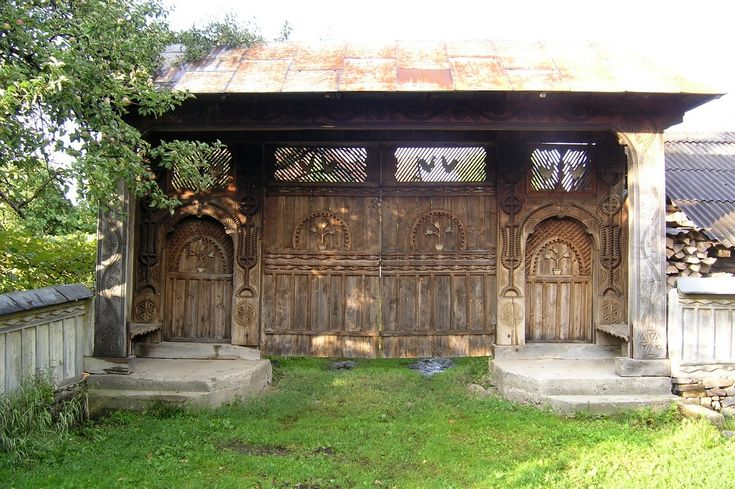 One of many carved private gates in Breb, Romania, the size of which denotes the owner's prestige in the village.