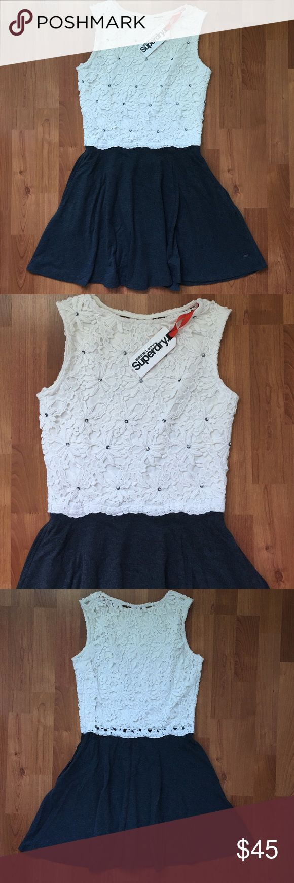 """SUPERDRY Grey White Fit N Flare Lace Skater Dress Superdry Coco Skater Dress. Dark grey and white lace dress with sequins and beads.   ❥ Color: Charcoal ❥ Cotton blend.  ❥ NWT. Stored in original bag. ❥ Skirt has pockets.   ❣ No trades. No PayPal. No holds. ❣ ❣ For offers, use the """"Offer"""" button below. ❣ Superdry Dresses"""
