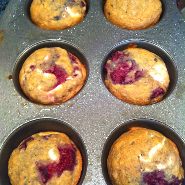 """Rocco Dispirito's Blueberry Cream Muffins from his """"Now Eat This! Diet"""" book, which is wonderful. I used raspberries obviously and I used half white flour half wheat because my wheat flour makes things too bread-like. I also used fat free cream cheese instead of reduced fat. I can't tell the difference  so I might as well go fat free.   They are about 145 calories and it makes 12. So delicious."""