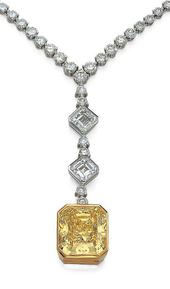 IMPORTANT FANCY VIVD YELLOW DIAMOND PENDENT NECKLACE. The fancy vivid yellow cut-cornered rectangular mixed-cut diamond weighing 32.53 carats suspended from a necklace set with brilliant- and step-cut diamonds, the clasp decorated with marquise-shaped stones, mounted in platinum and yellow gold, length approximately 440mm.