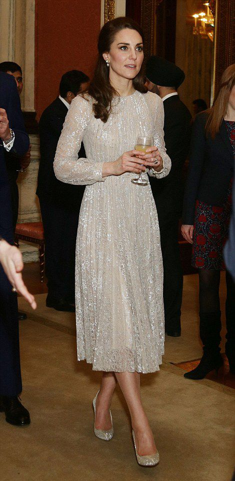 Catherine, Duchess of Cambridge steps out in a beautiful metallic dress by Erdem. She paired her stunning Erdem dress with £590 Oscar de la Renta pumps during a reception celebrating Britain's ties with India on February 27, 2017