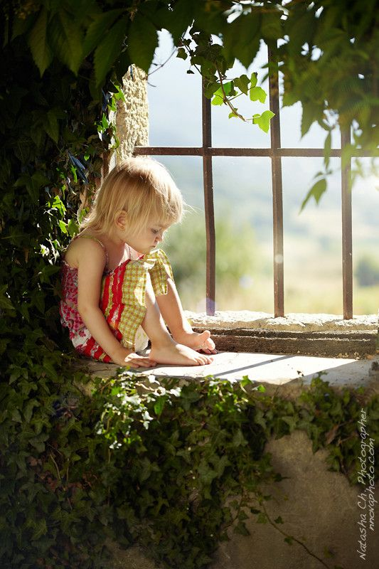 All she needs is a good book... This window seat would be the perfect spot!