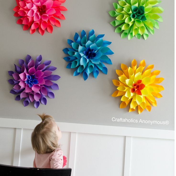 Learn how to make a Rainbow of Paper Dahlia flowers with this easy tutorial. Great paper craft to do with the kids! These flowers look AMAZING! Must see