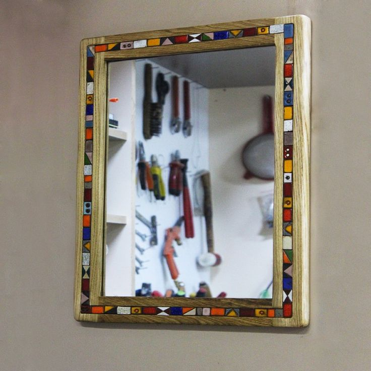 The mirror in wooden frame... Handmade mirror made from oak and surrounded by tiny ceramic tile. This product is designed in a rustic style.
