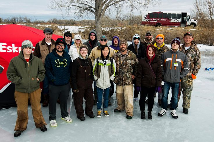 Students enrolled in HPER 120 pose during an ice fishing adventure at the Chadron City Ponds with Justin Haag, NEBRASKAland Magazine regional editor, seventh from right. (Photo courtesy Nebraska Game and Parks Commission)