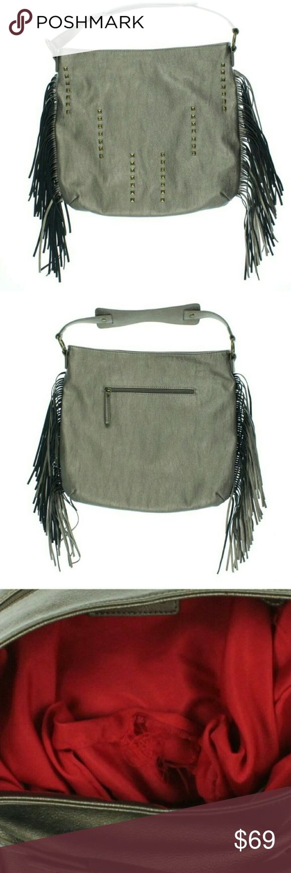 New Carlos Santana Faux Leather Metallic Fringe Ba This awesome brown metallic Hobo Handbag is a Carlos by Carlos Santana  it's new, but It has a 4 inch seam separation inside lining, outside is in perfect condition.  Details:  Manufacturer: Carlos Santana   Size: Large  Manufacturer Color: Brown Metallic  Condition: New with defects  Style type: Hobo Handbag  Handle type: Single  Closure: Snap  Inside zip, slip and cell pockets   Measures 14 x 15 1/2 x 2 1/2  Strap drop: 6 inches  Material…