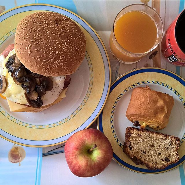 Sunday morning special: Breakfast sandwich with Emmental and smoked cheese, smoked pork, mortadella, salami, a couple of back bacon rashers, HP sauce, mozzarella, fried egg, sautéed mushrooms and green Tabasco sauce with a pain au chocolat, a slice of chocolate chip banana bread and a crispy apple on the side. #thenewbreakfasteverydayproject #livingmylifemyway