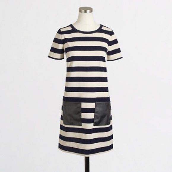 J. Crew Striped Shift Dress with Leather Pockets Dress stripes are navy and ivory with black leather-like pockets. The cotton dress is a heavier material perfect for the fall/winter. Pair with jackets, tights/leggings, ankle or tall boots--great versatility! This dress will even take you into spring. Like new--no flaws! J. Crew Dresses Mini