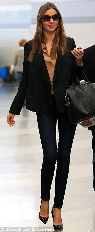 Immaculate: The Australian model donned heels, skinny jeans, a beige blouse and a tuxedo jacket
