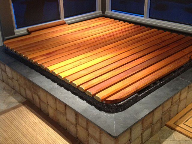 I'm going to build a hot tub cover and I could use some advice. Right now I'm thinking of a rolling cover kind of like [this](http://www.hot-tub-spa-covers.com/images/rollcover12.jpg) and [this](http://www.hot-tub-spa-covers.com/images/rollcover17.jpg). The slats on top won't...