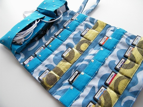 How clever and beautiful! A carrying case for your Nintendo handheld.  I saw someone else use it for a hair clip organizer.