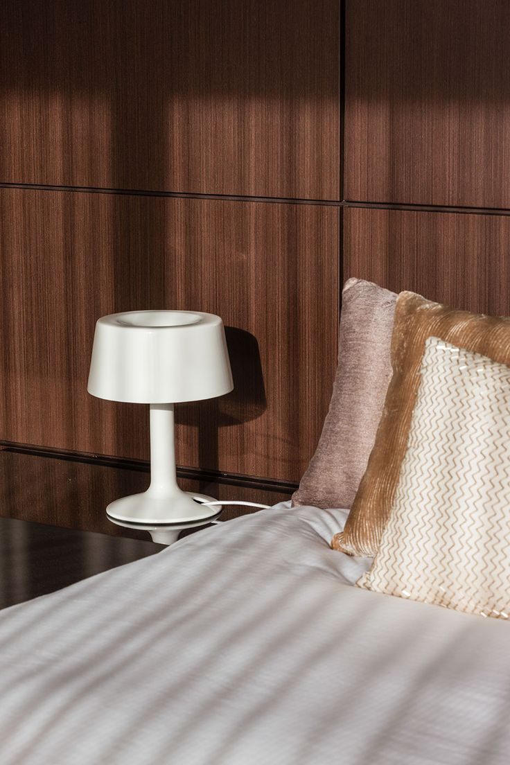 Warm tones in this headboard create a luxurious feel in the master bedroom designed and built by Urbane Projects