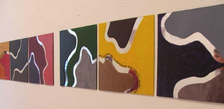 """Opera: L'amore è la perfezione Acrilico e pelle su specchio, 30 x 2,10, 2011.  Collettiva """"Amor Insania Mentis"""" Casa Balli, Locarno/Svizzera, 2011"""