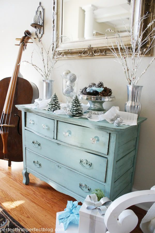 Love the sea glass color and clear knobs.