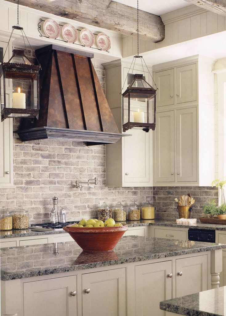 White washed brick backsplash + metal hood + hurricane pendants + marble just make it WHITE!!