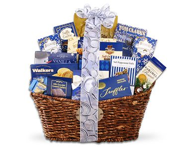 Make it A Valentine's to Remember! This gift basket packs some serious treats: cookies, candy, peppermint puffs, almond roca cookies, caramel popcorn and more make for a deliciously decadent indulgence to spoil that someone special!