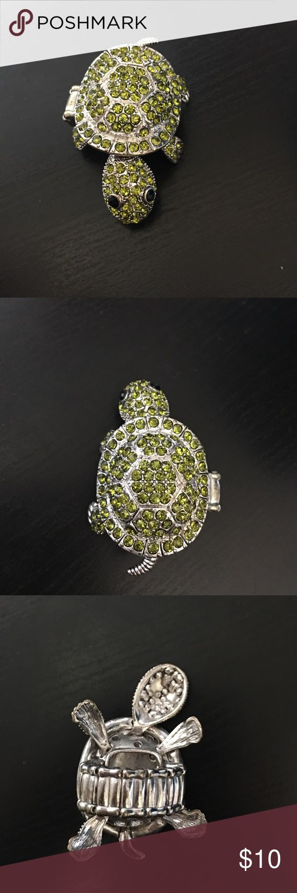 Moveable Turtle Ring Love turtles? Then this ring is perfect for you. Ring band is stretchy and will fit almost any finger. It has pretty green stones and none of them are missing. It's looking for a new home. Charming Charlie Jewelry Rings