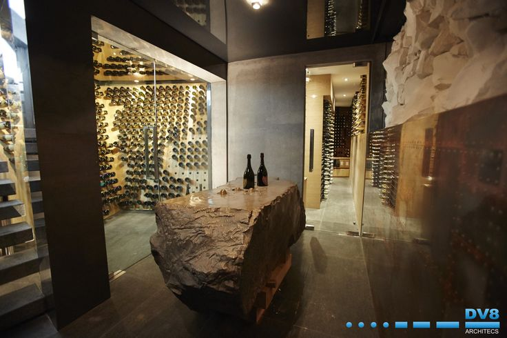 Ellerman House Wine Gallery Champagne Cellar. Moet & Chandon were kind enough to donate a block of limestone from the famous caves in Epernay. The block was used to cast the tasting table by Angus Taylor. The block was then broken up and used as wall cladding.