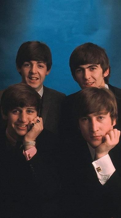 I swear there exists no picture of all four Beatles smiling at once, one of them…