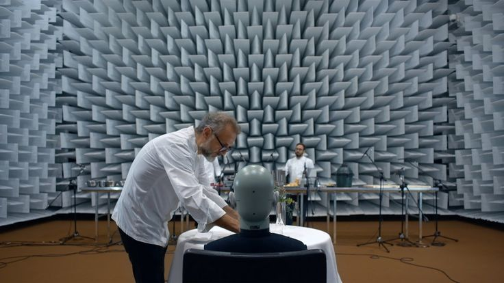 In a soundproof room filled with microphones, Massimo Bottura prepares a crunchy corner piece of lasagna — and serves it to a robot.