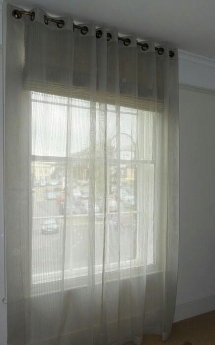Sheer curtains over blinds Can let light in without being