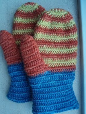 From Petras textila resa: Nalbinded mittens, based upon the fragment found in Grave 56 at Eura, and in the original color scheme.