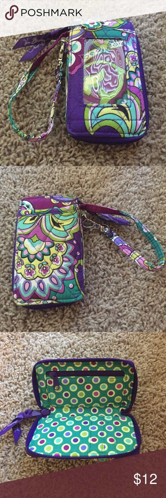 Vera Bradley Purple Wallet Never been used Vera Bradley Wallet! Has a very cute print on the inside and outside! Can be worn as wristlet. Price is negotiable. Vera Bradley Bags Wallets