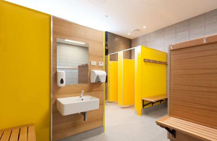 Changing room at St Mary's College Designed by RGC. Laminex HPL Olympia Yellow and Laminex Natural Timber Veneer Tasmanian Ash/Oak