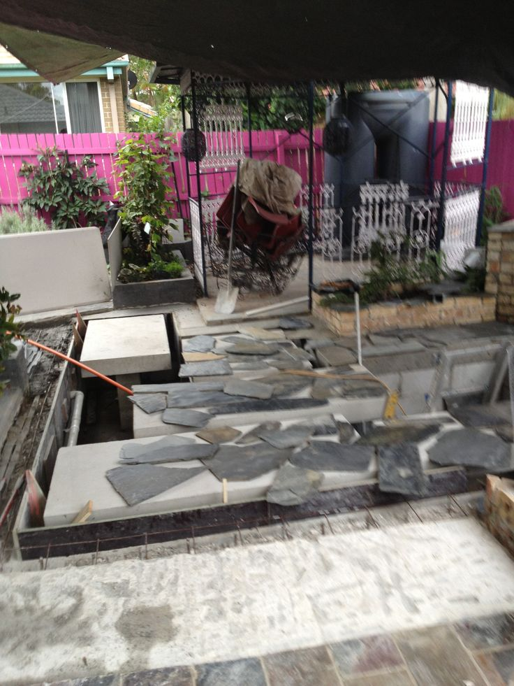 deciding which slate piece fits where- the slate is offcuts purchased for just $12 m2