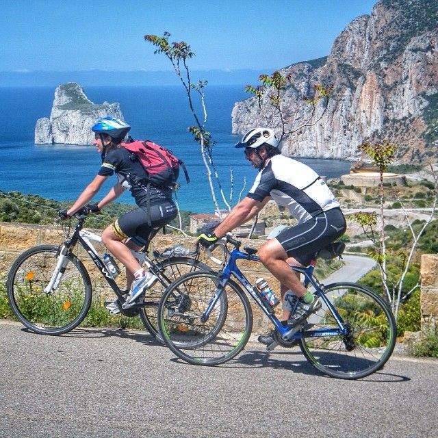 What a wonderful experience for the #biketravellers of Sardinia Grand Tour as they cycle past one of the most powerful natural monuments in #Sardinia. The seastacks of Pan di Zucchero get their name from the famous Pão de Açucar of Rio de Janeiro. We're here in the south-west of the island in the province of Carbonia Iglesias not far from the striking mining site of Porto Flavia.  #sardegna #italy